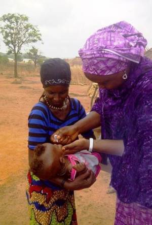 Oral polio vaccine being administered to a child in Nigeria (courtesy of CC).